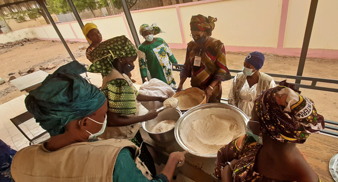 Mothers mixing flours during a nutrition demonstration