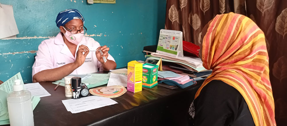 Haby counsels a mother on family planning options